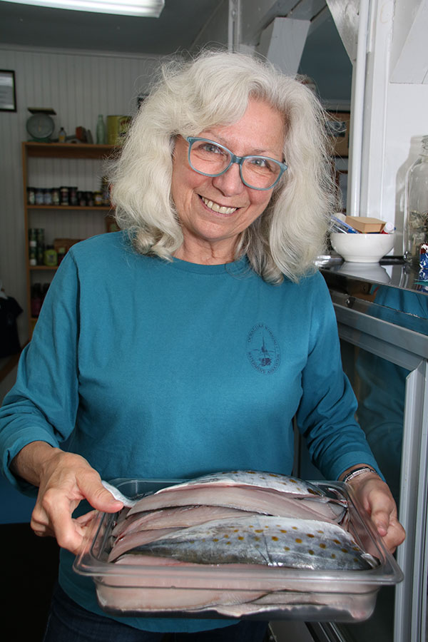 Pattie Johnson Plyler and a sampling of fresh wild caught seafood