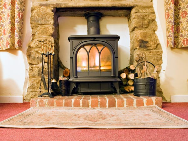 Fireplace vs. Woodstove - Fireplace Vs. Woodstove - Carolina Country