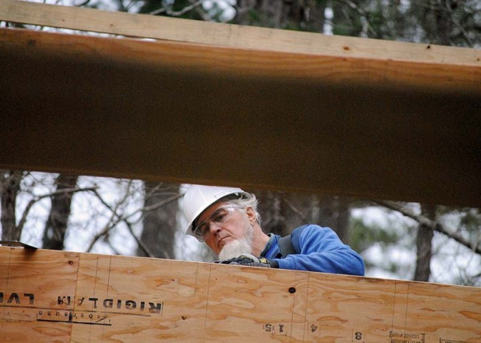Amish craftsmen raise a building for the 4-H at Millstone Camp