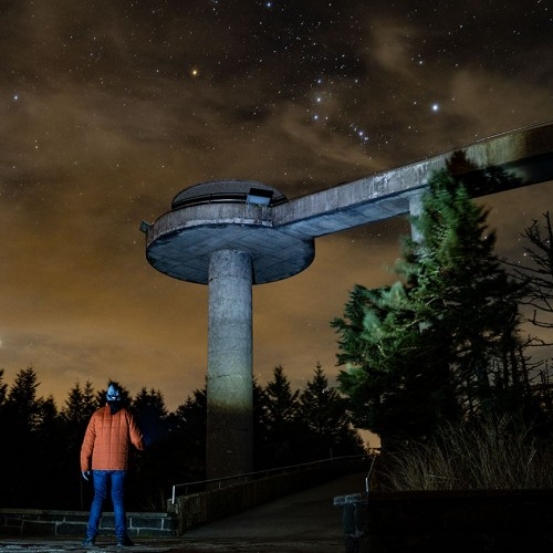 Captured on a windy autumn night atop the Great Smoky Mountain range, this photo showcases Clingmans Dome under a starry night sky. This iconic landmark straddles the edge of North Carolina with Tennessee. —Bradley Harrison, Mooresville