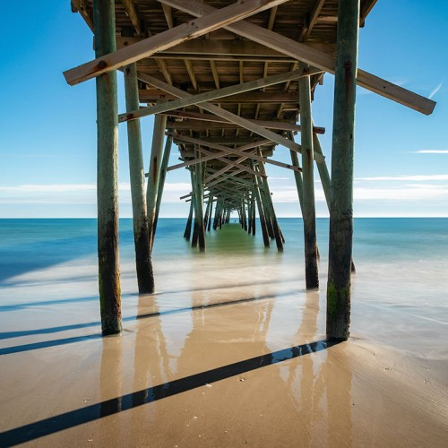 The Oceanana Pier in Atlantic Beach was rather bent and warped by the force of Hurricane Florence. And yet, despite the storm, it remained standing, resolute. —Eifel Kreutz, Mount Airy