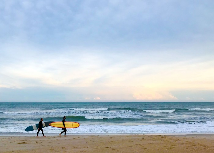 Two surfers leaving Wrightsville Beach after a day of surfing in late fall. —Janet Beal, Leland, Brunswick Electric