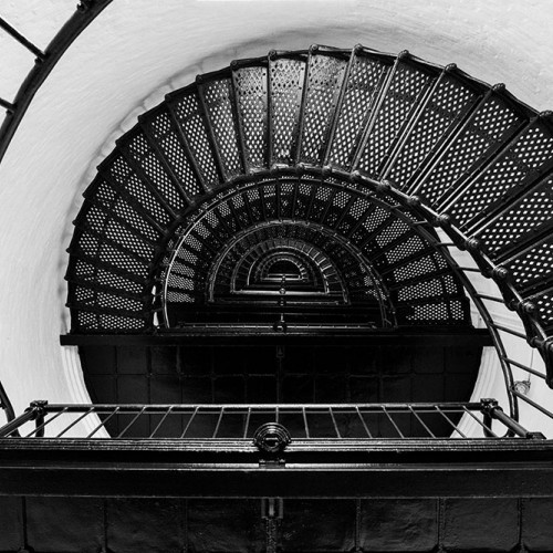 The spiral stairs leading to the light of the Bodie Island Lighthouse creates a beautiful geometric pattern when photographed looking up. —Joel Miller, Hickory, Blue Ridge Energy