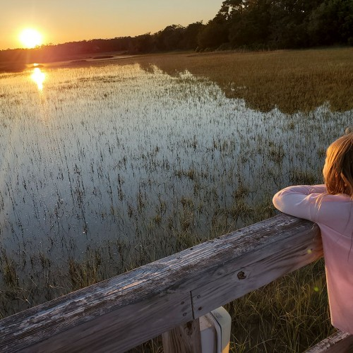 My granddaughter was admiring the sunset over the water at Southport Marina overlooking the marsh at high tide. I love the way the reflection on the water creates a cross. —Lisa Merritt, Bolivia, Brunswick Electric