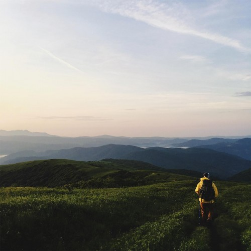 My husband and I enjoy hiking the same section of the Appalachian Trail every spring. We camp here, at the top of Hump Mountain, and are rewarded with the beautiful sunrise over these ancient, green mountains. —Shannon Mills, Wake Forest, Wake Electric