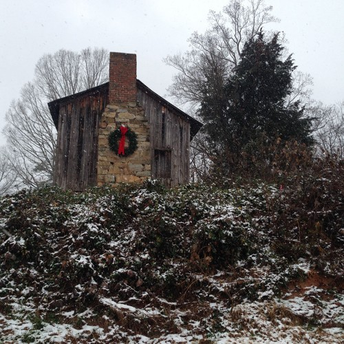 I took this photo of a cabin on a hill at Christmas in Iron Station. —Sherri Noto, Iron Station, Rutherford EMC